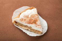 A slice of tasty fresh baked apple pie with cheese and cream stock photo
