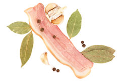 Slice of tasty pork bacon and spices royalty free stock photography