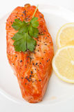 Slice of tasty salmon with lemon Stock Photography
