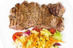 Slice tenderloin with salad Stock Images