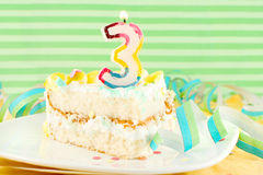 Slice of third birthday cake Royalty Free Stock Images
