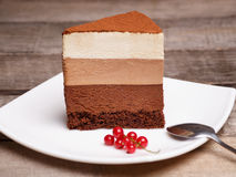 Slice of the three chocolate mousse cake Royalty Free Stock Photography