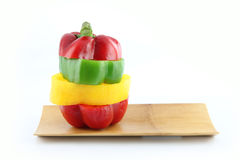 Slice the Three color of bell pepper in Arranged vertically. Royalty Free Stock Photos
