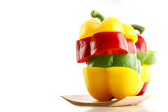 Slice the Three color of bell pepper in Arranged vertically. Royalty Free Stock Image