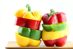 Slice the Three color of bell pepper in Arranged vertically. Stock Image