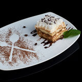Slice of tiramisu cake Stock Photos