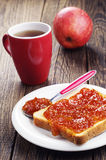 Slice toast bread with jam and tea Royalty Free Stock Image