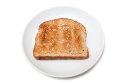 Slice of toast on plate Royalty Free Stock Photos