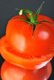 Slice tomato. Fresh juicy red slice tomato with drops Stock Images