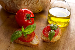 Slice tomato. And basil over slice bread stock image