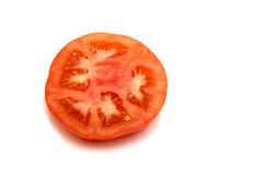 Slice of tomato. Isolated on the white background royalty free stock photo