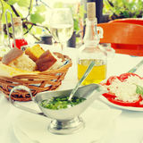 Slice tomato, bread and olive oil in outdoor cafe Royalty Free Stock Photo