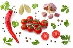 slice of tomato with chili pepper, garlic and parsley isolated on white background. top view Stock Photos