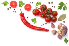 Slice of tomato with chili pepper, garlic and parsley isolated on white background. top view stock images