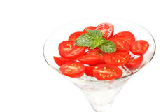 Slice tomato with ice in cocktail glass Royalty Free Stock Images