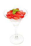 Slice tomato with ice in cocktail glass Stock Photos