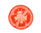 Slice of tomato isolated close-up Stock Photography