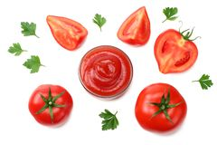 Slice of tomato with parsley and glass bowl of ketchup isolated on white background. top view stock photography