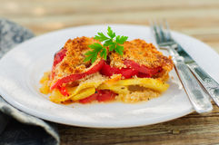 A Slice of Tomato, Red Capsicum, Zucchini and Feta Gratin Royalty Free Stock Photo