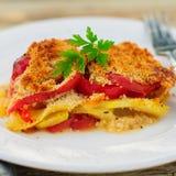 A Slice of Tomato, Red Capsicum, Zucchini and Feta Gratin Stock Photo