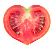 Slice of tomato in the shape of heart Stock Images