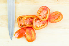 Slice Tomato on a Wooden Cutting Board Royalty Free Stock Photography