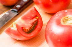 Slice tomatoes on a cutting board and knife Stock Photography