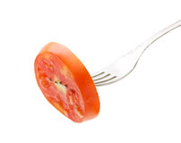 Slice tomatoes on a fork Royalty Free Stock Photography