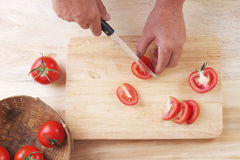 Slice Tomatoes in Half, Prepare tomato for cooking Stock Photos