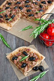 Slice of tuna tart with olives and onions Royalty Free Stock Image