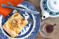 Slice of Turkish borek served with a cup of tea Royalty Free Stock Photography