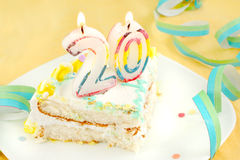 Slice of twentieth birthday cake Royalty Free Stock Photo