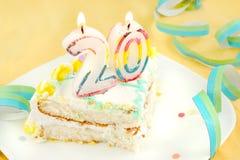 Slice of twentieth birthday cake Royalty Free Stock Photo