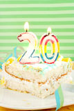 Slice of twentieth birthday cake Stock Image