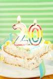 Slice of twentieth birthday cake Stock Image