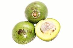Slice Two green thai avocado on white background. Slice Two of green thai avocado on white background royalty free stock images