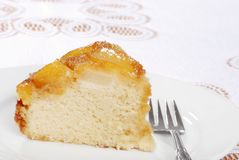 Slice of upside down pear cake with a fork Royalty Free Stock Photography