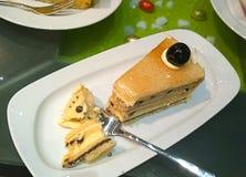 Slice of vanilla cake with cherry top Royalty Free Stock Photo