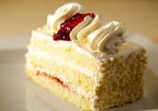 Slice of vanilla cake. Slice of vanilla cream cake Royalty Free Stock Image