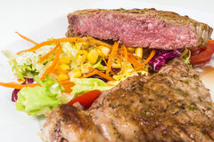 Slice veal rare with salad Royalty Free Stock Images