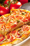 Slice of vegetarian pizza. With different vegetables Royalty Free Stock Photography