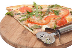 SLICE VEGETARIAN RUCOLA TOMATO PIZZA WOODEN BOARD Stock Images