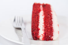 Slice of velvet cake with fork on white plate Stock Images