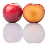 Slice Of Victoria Plum Or Red Plum III royalty free stock photography