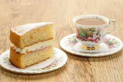 Slice of Victoria sponge cake with a hot drink Stock Image