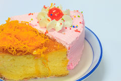 Slice of Victoria sponge cake. On plate background Stock Images