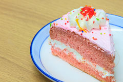 Slice of Victoria sponge cake. On plate background Royalty Free Stock Image