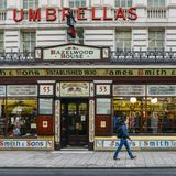 Slice of Victorian London is thriving on Oxford Street, London with James Smith and Sons Umbrella Shop. London, UK - Mar 6, 2018: Slice of Victorian London is Stock Photos