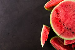 Slice watermelon. On black background. top view. Left space for text Royalty Free Stock Photo