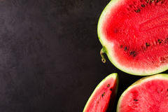 Slice watermelon. On black background. top view. Left space for text Stock Photos